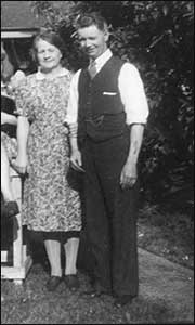 Reg & his wife in the garden