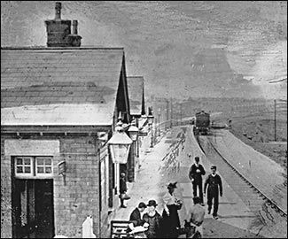 Rushden Station showing a train arriving from Wellingborough
